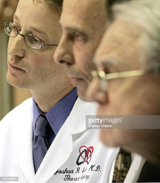 Thoracic surgeon Dr Joshua Sonett who will perform the surgery on former US President Bill Clinton sits with Cardiology chief Dr Allan Schwartz and...