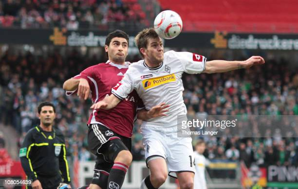 Thorben Marx and Mehmet Ekici of Nuremberg battle for the ball during the Bundesliga match between 1 FC Nuernberg and Borussia Moenchengladbach at...