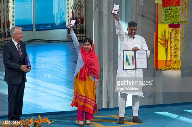 Thorbjorn Jagland of Norway looks on as Malala Yousafzai and Kailash Satyarthi accept their Nobel Peace Prize Award during the Nobel Peace Prize...