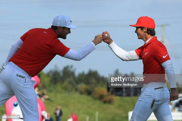Thorbjorn Olesen and Lucas Bjerregaard of Denmark celebrate on the 5th green during the final match between Denmark and Australia during day two of...