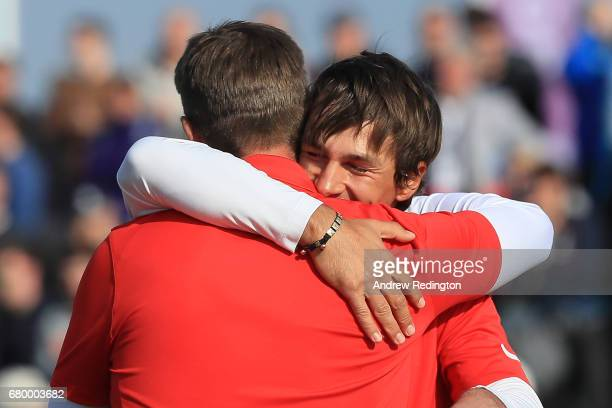 Thorbjorn Olesen and Lucas Bjerregaard of Denmark celebrate victory on the 6th green during the final match between Denmark and Australia during day...