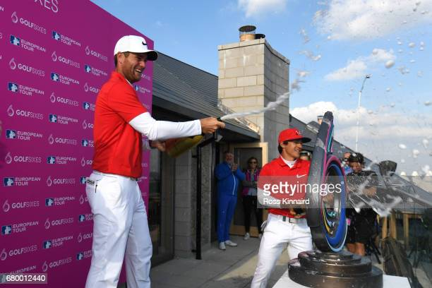 Thorbjorn Olesen and Lucas Bjerregaard of Denmark celebrate victory with champagne after the final match between Denmark and Australia during day two...
