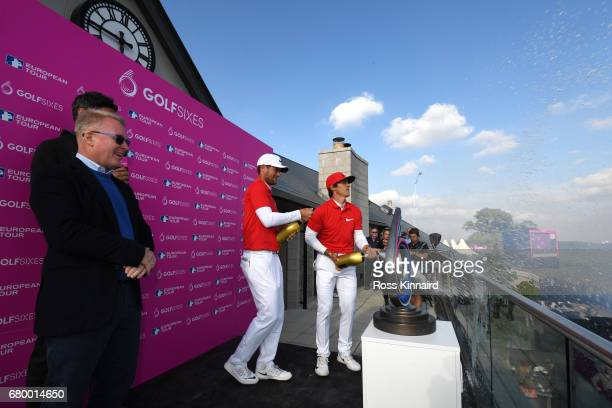 Thorbjorn Olesen and Lucas Bjerregaard of Denmark celebrate victory with champagne as European Tour Chief Executive Keith Pelley looks on after the...