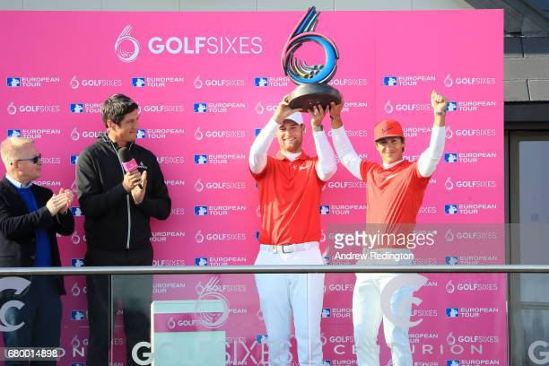 Thorbjorn Olesen and Lucas Bjerregaard of Denmark celebrate with the trophy after winning the final match between Denmark and Australia during day...