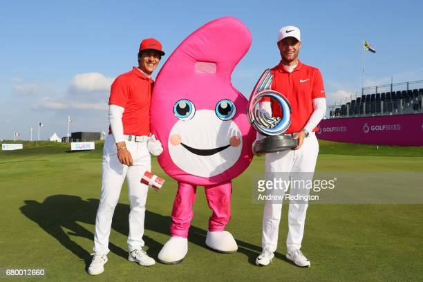 Thorbjorn Olesen and Lucas Bjerregaard of Denmark pose with the trophy and the GolfSixes mascot after winning the final match between Denmark and...