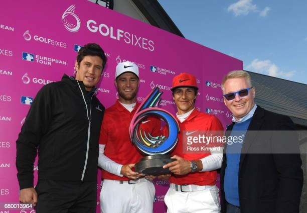 Thorbjorn Olesen and Lucas Bjerregaard of Denmark pose with the trophy and European Tour Chief Executive Keith Pelley and Vernon Kay after winning...