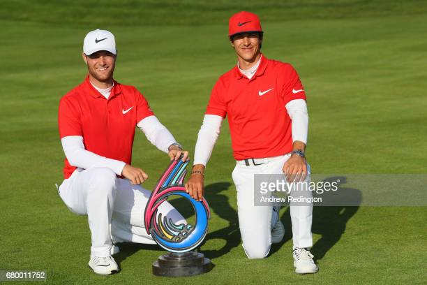 Thorbjorn Olesen and Lucas Bjerregaard of Denmark pose with the trophy after winning the final match between Denmark and Australia during day two of...