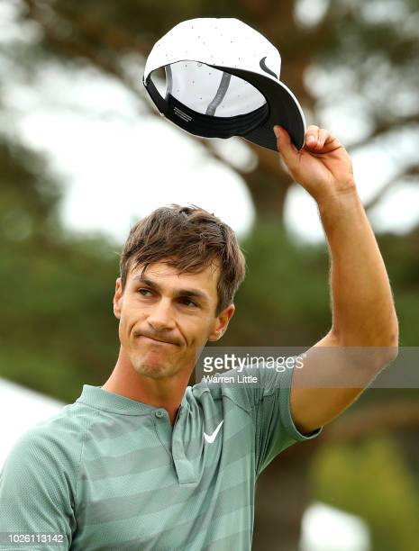 Thorbjorn Olesen of Denmark acknowledges the crowd on the 18th green during the final round on day four of the Made in Denmark played at the...