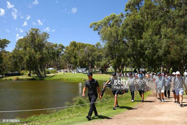 Thorbjorn Olesen of Denmark and Danny Willett of England walk to the 8th green during day two of the World Super 6 at Lake Karrinyup Country Club on...