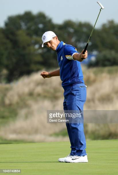 Thorbjorn Olesen of Denmark and the European Team celebrates holing a birdie putt on the 14th hole to win his match against Jordan Spieth by 54...