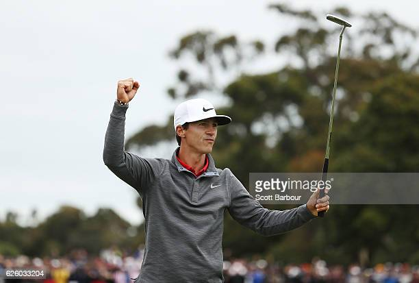 Thorbjorn Olesen of Denmark celebrates after making a birdie on the 18th hole to win the tournament during day four of the World Cup of Golf at...