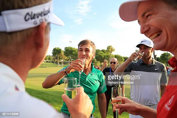 Thorbjorn Olesen of Denmark celebrates with champagne and his fellow Danish golfers Lucas Bjerregaard, Lasse Jensen and Soren Kjeldsen following his...