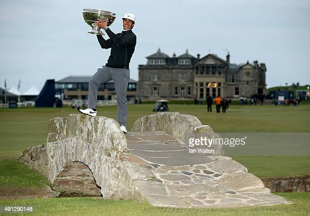 Thorbjorn Olesen of Denmark holds the trophy aloft on the Swilcan Bridge on the 18th hole after victory in the 2015 Alfred Dunhill Links Championship...
