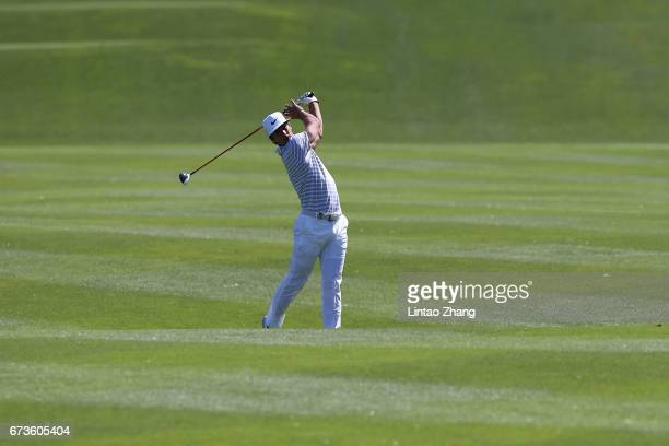 Thorbjorn Olesen of Denmark plays a shot during the first round of the 2017 Volvo China open at Topwin Golf and Country Club on April 27 2017 in...