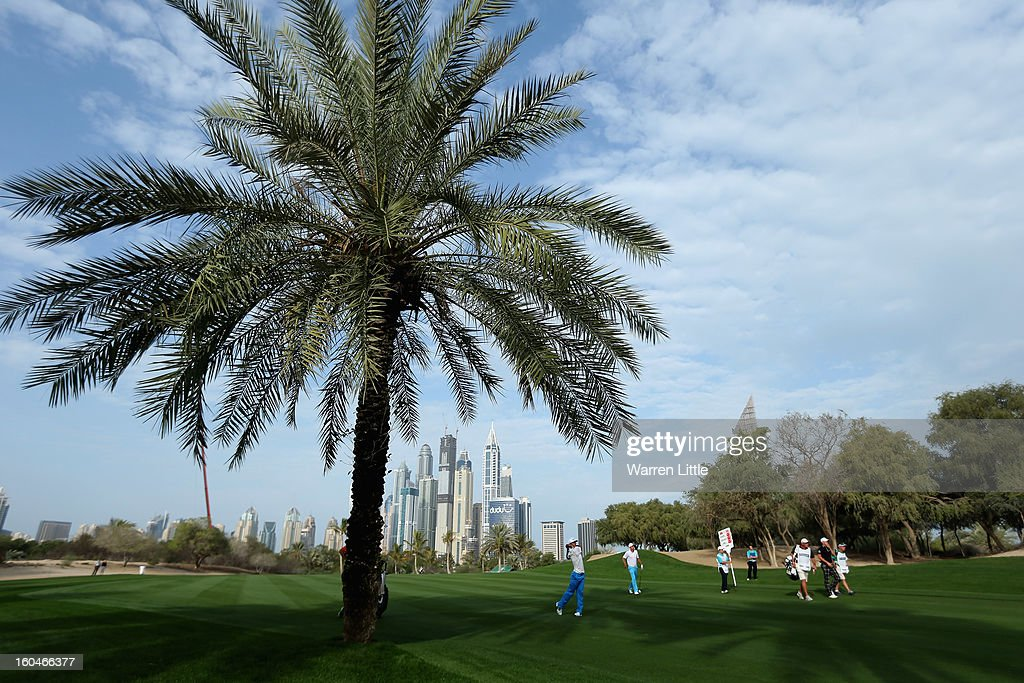 Thorbjorn Olesen of Denmark plays his second shot into the 13th green during the second round of the Omega Dubai Desert Classic at Emirates Golf Club on February 1, 2013 in Dubai, United Arab Emirates.