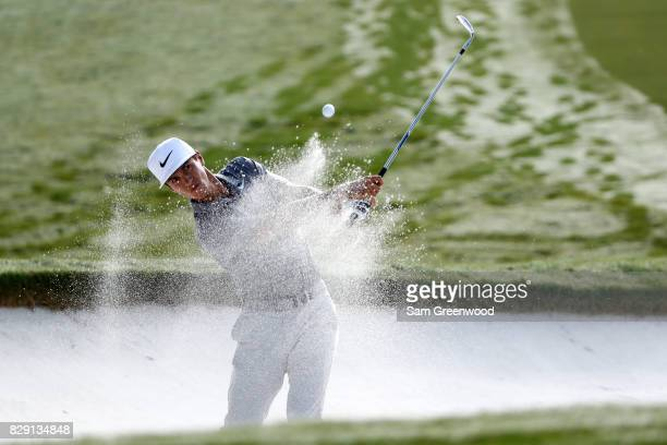 Thorbjorn Olesen of Denmark plays his shot out of the bunker on the first hole during the first round of the 2017 PGA Championship at Quail Hollow...