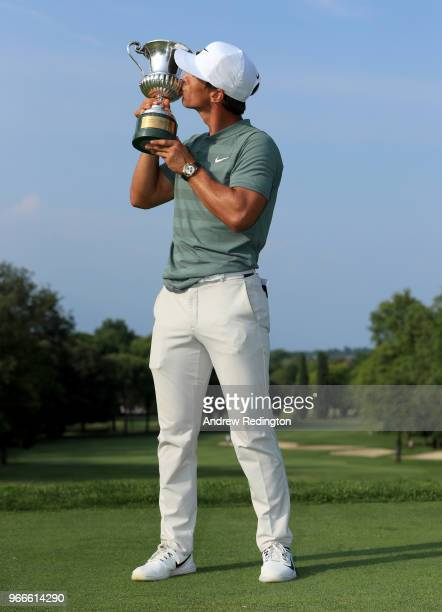 Thorbjorn Olesen of Denmark poses with the Italian Open trophy after victory in the competition during the final round of the Italian Open at...