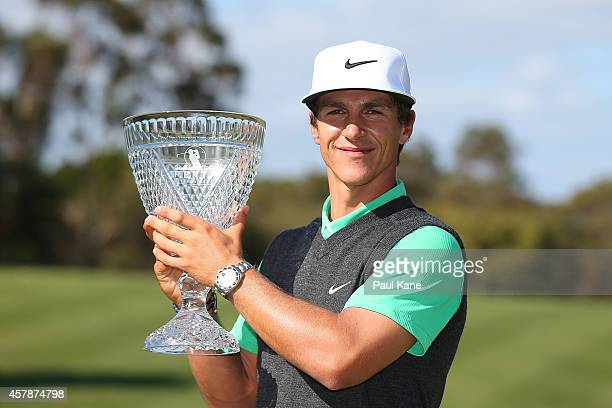 Thorbjorn Olesen of Denmark poses with the trophy after winning the 2014 Perth International at Lake Karrinyup Country Club on October 26, 2014 in...