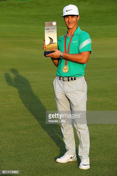 Thorbjorn Olesen of Denmark poses with the trophy following his victory during day four of the Turkish Airlines Open at the Regnum Carya Golf Spa...