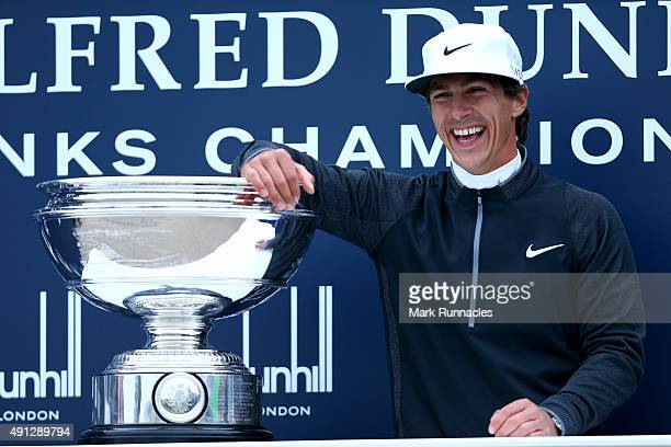 Thorbjorn Olesen of Denmark poses with the trophy on the 18th green after victory in the 2015 Alfred Dunhill Links Championship at The Old Course on...
