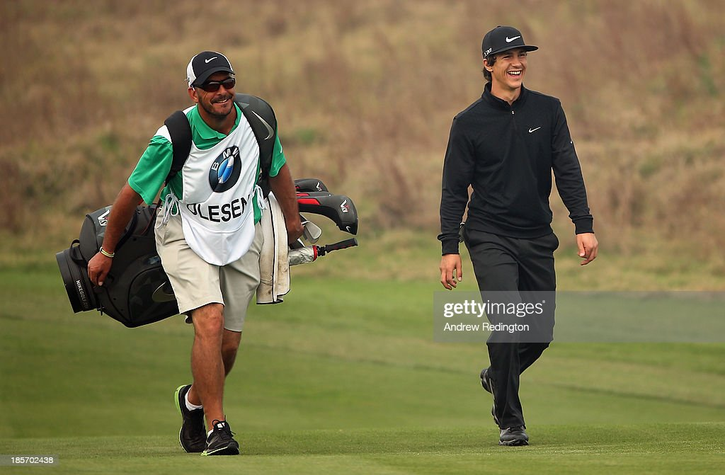Thorbjorn Olesen of Denmark shares a joke with is caddie Ken Herring during the first round of the BMW Masters at Lake Malaren Golf Club on October 24, 2013 in Shanghai, China.