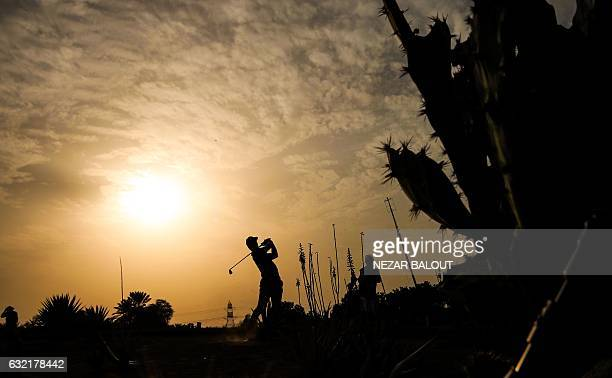 Thorbjorn Olesen of Denmark takes a shot during the second round of the Abu Dhabi Golf Championship in the capital of the United Arab Emirates on...