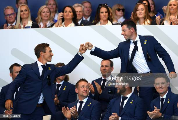 Thorbjorn Olesen of Europe and Rory McIlroy of Europe react after being matched against Dustin Johnson of the United States and Rickie Fowler of the...