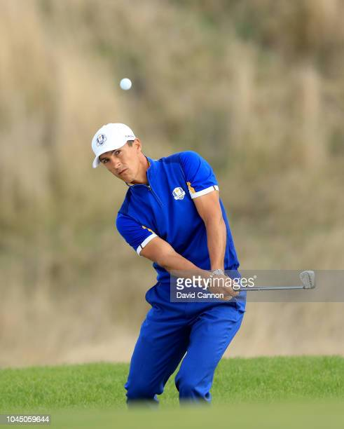 Thorbjorn Olesen of The European Team plays his third shot on the 14th hole in his match against Jordan Spieth of the United States team during the...