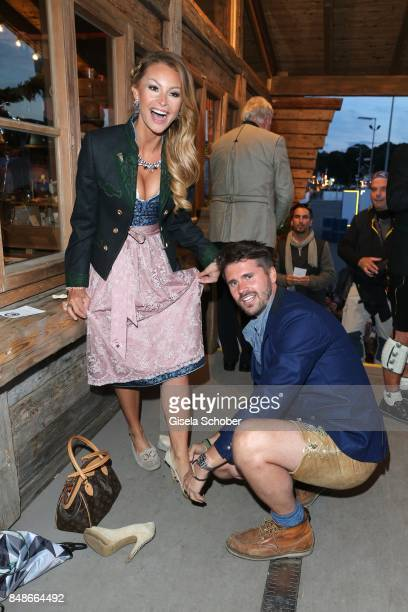 Thore Schoelermann and his girlfriend Jana Julie Kilka helps her in her shoes during the 'Almauftrieb' as part of the Oktoberfest 2017 at...