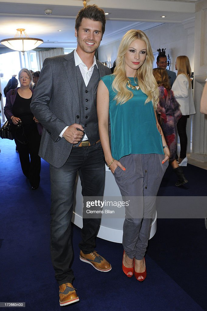 Thore Schoelermann and Jana Julie Kilka attend the Dawid Tomaszewski Show during the Mercedes-Benz Fashion Week Spring/Summer 2014 at Brandenburg Gate on July 4, 2013 in Berlin, Germany.