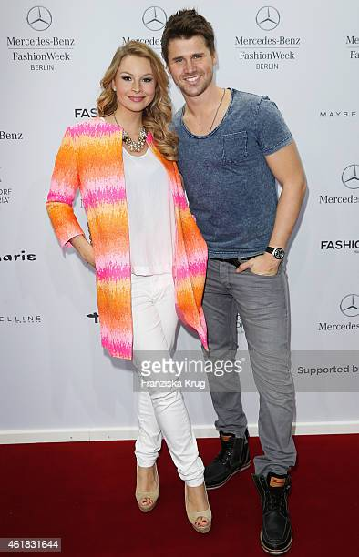 Thore Schoelermann and Jane Julie Kilka attends the Marc Cain show during the MercedesBenz Fashion Week Berlin Autumn/Winter 2015/16 at Brandenburg...