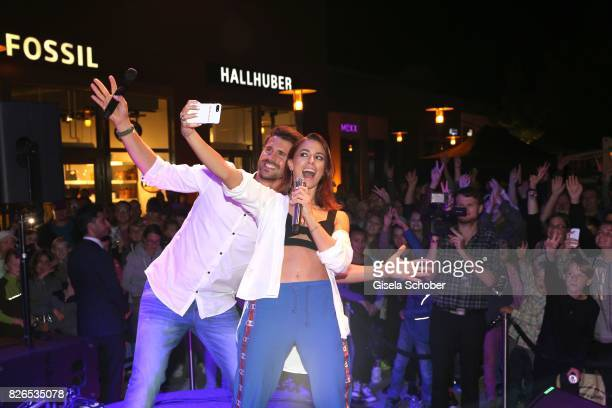 Thore Schoelermann and Vanessa Mai during the late night shopping at Designer Outlet Soltau on August 4 2017 in Soltau Germany