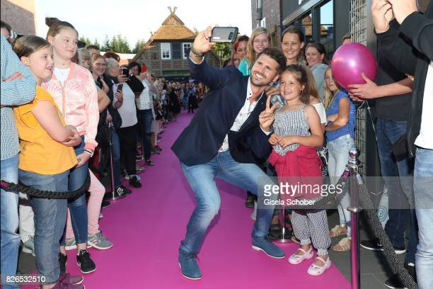 Thore Schoelermann takes a selfie with fans during the late night shopping at Designer Outlet Soltau on August 4 2017 in Soltau Germany