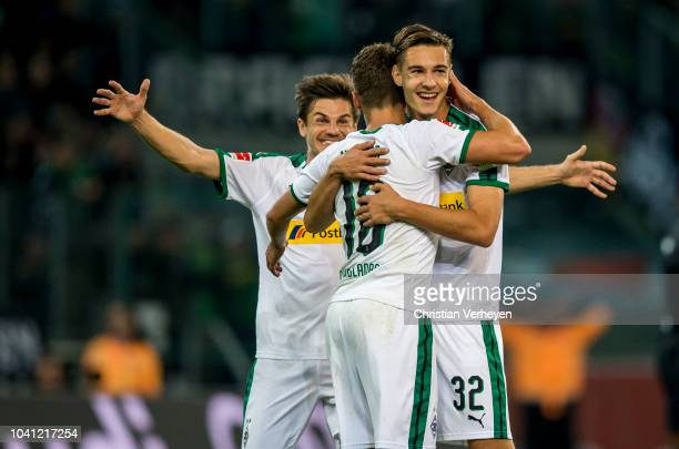 Thorgan Hazard and Florian Neuhaus and Jonas Hofmann of Borussia Moenchengladbach celebrate the goal during the Bundesliga match between Borussia...