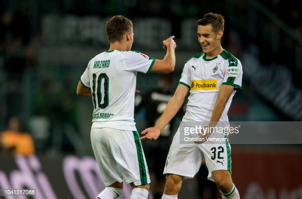 Thorgan Hazard and Florian Neuhaus of Borussia Moenchengladbach celebrate the goal during the Bundesliga match between Borussia Moenchengladbach and...