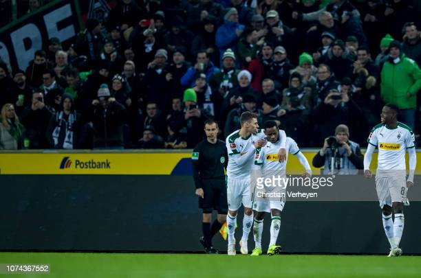 Thorgan Hazard and Ibrahima Traore of Borussia Moenchengladbach celebrate the first goal during the Bundesliga match between Borussia...