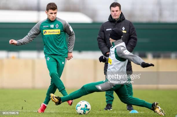 Thorgan Hazard and Julio Villalba of Borussia Moenchengladbach in action during a training session of Borussia Moenchengladbach at BorussiaPark on...