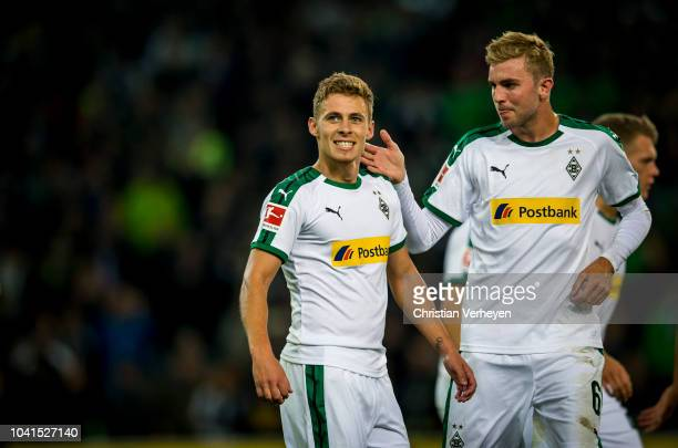 Thorgan Hazard celebrate with team mate Christoph Kramer after he scores his teams second goal during the Bundesliga match between Borussia...