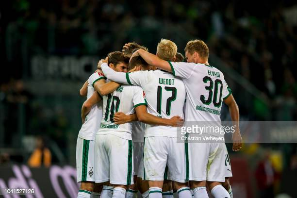 Thorgan Hazard celebrate with team mate Florian Neuhaus after he scores his teams second goal during the Bundesliga match between Borussia...