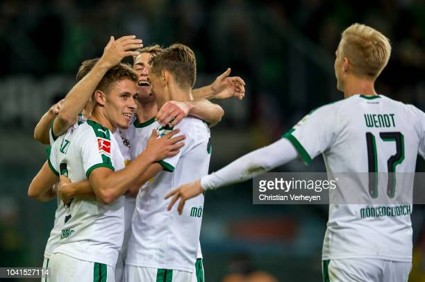 Thorgan Hazard celebrate with team mates after he scores his teams second goal during the Bundesliga match between Borussia Moenchengladbach and...