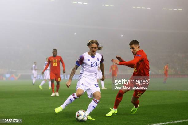 Thorgan Hazard of Belgium battles for the ball with Ari Skulason of Iceland during the UEFA Nations League A group two match between Belgium and...