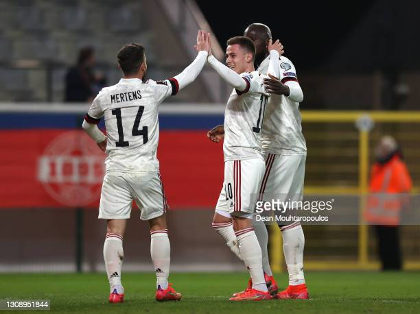Thorgan Hazard of Belgium celebrates after scoring his sides second goal with Dries Mertens and Romelu Lukaku during the FIFA World Cup 2022 Qatar...