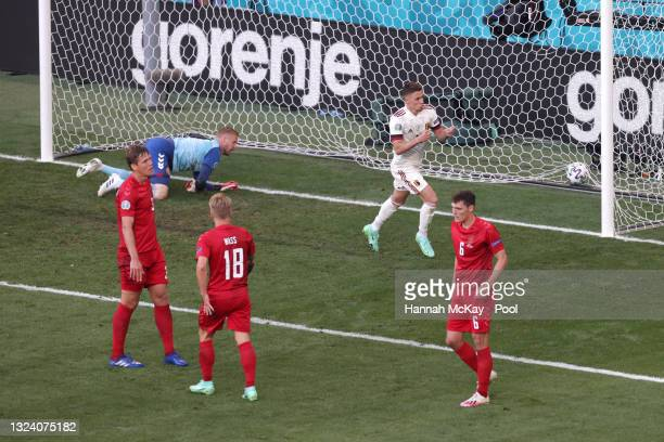Thorgan Hazard of Belgium celebrates after scoring their side's first goal during the UEFA Euro 2020 Championship Group B match between Denmark and...