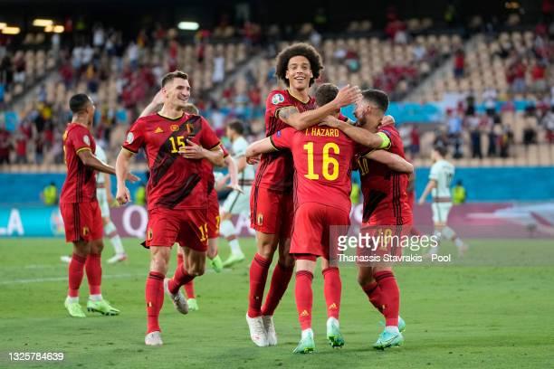 Thorgan Hazard of Belgium celebrates Thomas Meunier, Axel Witsel and Eden Hazard after scoring their side's first goal during the UEFA Euro 2020...