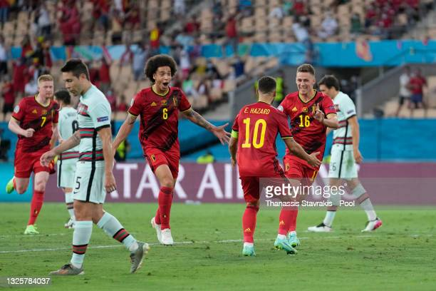 Thorgan Hazard of Belgium celebrates with Axel Witsel and Eden Hazard after scoring their side's first goal during the UEFA Euro 2020 Championship...