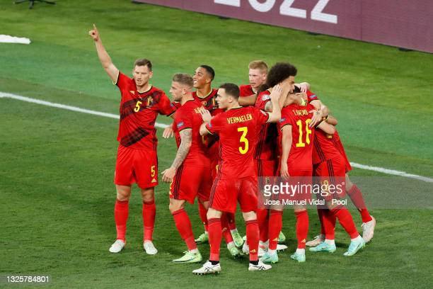 Thorgan Hazard of Belgium celebrates with team mates after scoring their side's first goal during the UEFA Euro 2020 Championship Round of 16 match...