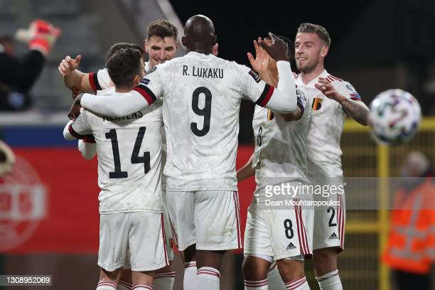 Thorgan Hazard of Belgium celebrates with teammates after scoring his sides second goal during the FIFA World Cup 2022 Qatar qualifying match between...
