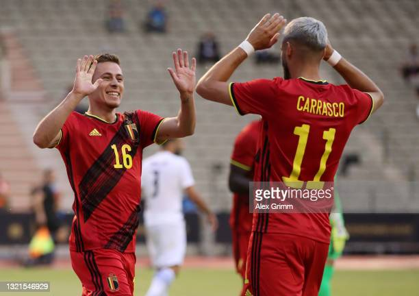 Thorgan Hazard of Belgium celebrates with Yannick Carrasco after scoring their side's first goal during the international friendly match between...