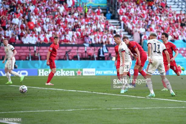 Thorgan Hazard of Belgium scores their side's first goal during the UEFA Euro 2020 Championship Group B match between Denmark and Belgium at Parken...