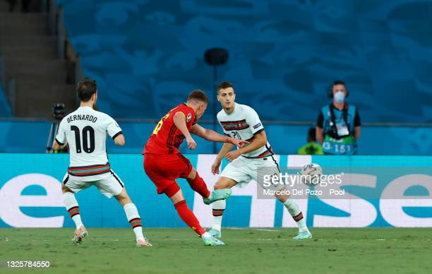 Thorgan Hazard of Belgium scores their side's first goal during the UEFA Euro 2020 Championship Round of 16 match between Belgium and Portugal at...
